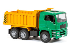 Tipper. The toy dump truck on a white background royalty free stock images