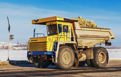 Tipper. Truck goes to quarry. Winter Belarus Vitebsk 2013. Dolomite mining Royalty Free Stock Photos