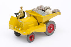 Tipper truck. Toy Tipper/Dump truck conceptualizing both work royalty free stock photos