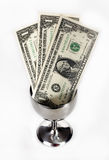 Tipping Cup. Dollar bills in a silver tip cup Royalty Free Stock Image