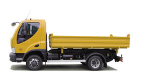 Tipping lorry. Yellow tipping lorry isolated on white Stock Photo
