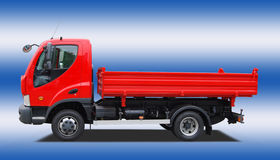 Tipping lorry. Isolated on blue-white  background Stock Photos