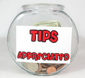Tips Appreciated. Tip jar with currency and coings Stock Photos