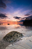Tips of borneo sunset with stone vertical view. This shoot taken during sunset at tips of borneo near south china sea royalty free stock image