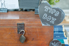 The tips box for good service in restaurant. Stock Photography