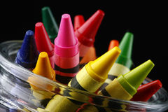 Tips of colored crayons in jar, angled Royalty Free Stock Photos