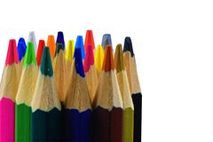 Tips of colored pencils on white background. Back to school. Copy space. Close up stock image