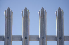 Tips of galvanized steel safety fence  Royalty Free Stock Image