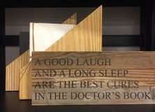 Tips about healthy and bookshelves. Useful tips about healthy print on wood , a good laugh and a long sleep are the best curse in the doctor`s book Royalty Free Stock Images