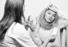Tips how to get rid of cold. Recognize symptoms of cold. Remedies should help beat cold fast. Woman consult with doctor. Girl in scarf hold tissue while doctor stock photos