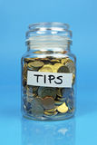 Tips jar filled with coins Royalty Free Stock Photography