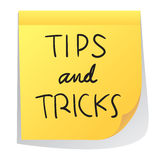 Tips nd Tricks. Vector illustration of sticky paper with Tips nd Tricks words written on it Stock Photos