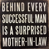 Tips about successful man. Behind every successful man is a surprised mother-in-law royalty free stock photography