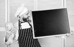 Tips to cook like pro. Man chef hat apron hold blackboard copy space. Recipe concept. Cooking delicious meal step by. Step. Menu for today. List ingredients for stock photos