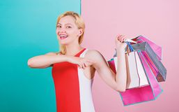 Tips to shop sales successfully. Buy everything you want. Girl satisfied with shopping. Girl enjoy shopping or just got. Birthday gifts. Woman red dress hold stock image