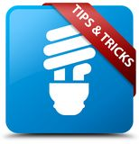 Tips and tricks (bulb icon) cyan blue square button red ribbon i Stock Image