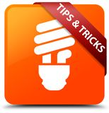 Tips and tricks (bulb icon) orange square button red ribbon in c. Tips and tricks (bulb icon) isolated on orange square button with red ribbon in corner abstract Stock Photography