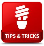 Tips and tricks (bulb icon) red square button red ribbon in midd. Tips and tricks (bulb icon) isolated on red square button with red ribbon in middle abstract Stock Photo