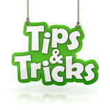 Tips and Tricks green text icon hanging isolated on white. With clipping path Royalty Free Stock Photos
