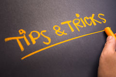 Tips and Tricks. Hand writing text Tips and Tricks on chalkboard stock photography