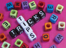 Tips & Tricks. Tips and tricks puzzle words concept Stock Images