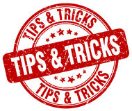 Tips & tricks red grunge round stamp Royalty Free Stock Images