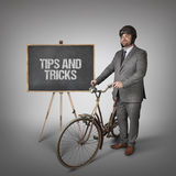 Tips and tricks text on blackboard with businessman Royalty Free Stock Photo