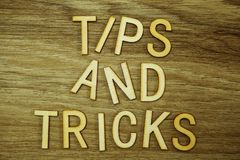 Tips and Tricks text message on wooden background. Tips and Tricks text message with space copy on wooden background stock photo