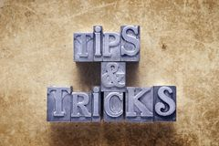 Tips and tricks. Label made from metallic letterpress type on vintage cardboard stock photography