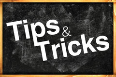 Tips and tricks. Title on black chalkboard royalty free stock photography