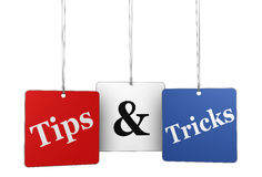 Tips And Tricks Web Tags. Website, Internet and blog concept with tips & tricks word and sign on hanged tags isolated on white background Stock Photography