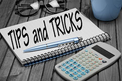 Tips and Tricks word. On notepad Stock Photography