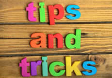 Tips and Tricks word. On wooden table Stock Image