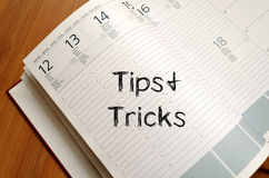 Tips and tricks write on notebook Stock Image