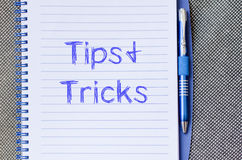 Tips and tricks write on notebook Stock Photos