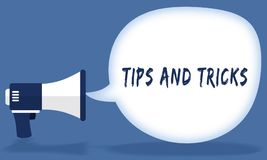 TIPS AND TRICKS writing in speech bubble with megaphone or loudspeaker. Illustration concept Royalty Free Stock Photo