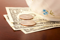 Tips. In US dollars on a restaurant table Royalty Free Stock Photo
