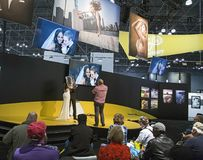 The 2017 Photoplus Expo. Tips on wedding photography are imparted by a photographer using models, equipment, and displays to instruct onlookers and sell Royalty Free Stock Image