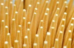 Tips of wooden toothpicks. Macrophotography of the tips of toothpicks used for removing detritus after meal or as cocktail sticks Stock Photo