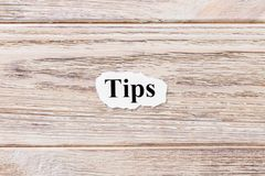 TIPS of the word on paper. concept. Words of TIPS on a wooden background.  stock photography