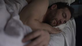 Tipsy male having sound sleep on sofa bed, breathing with open mouth, recovery. Stock footage stock video footage