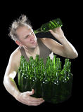 Tipsy man wants to drink the last drink of beer from an empty bottle Stock Photography