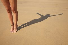 Tiptoe shade woman Stock Photography