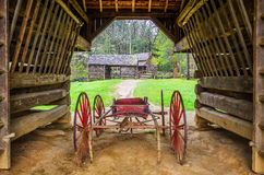 TiptonPlace, cantilever barn, Cades Cove. The Tipton Place is seen from inside the old Cantilever barn in Cades Cove of the Great Smoky Mountains Royalty Free Stock Photos