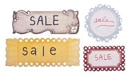 Étiquettes manuscrites de vente Photo stock