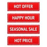 Étiquettes rouges de tissu de promotion Photographie stock