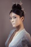 Tiré d'une jeune femme asiatique futuriste Photographie stock