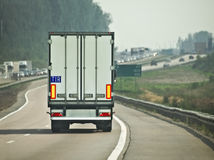 TIR. Back of lorry trailer in motion Stock Images