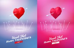 Tir de coeur Coeur rouge de deux origamis percé par Image stock