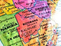 Tir de foyer du Botswana Afrique macro sur la carte de globe pour des blogs de voyage, le media social, des bannières de site Web Images stock